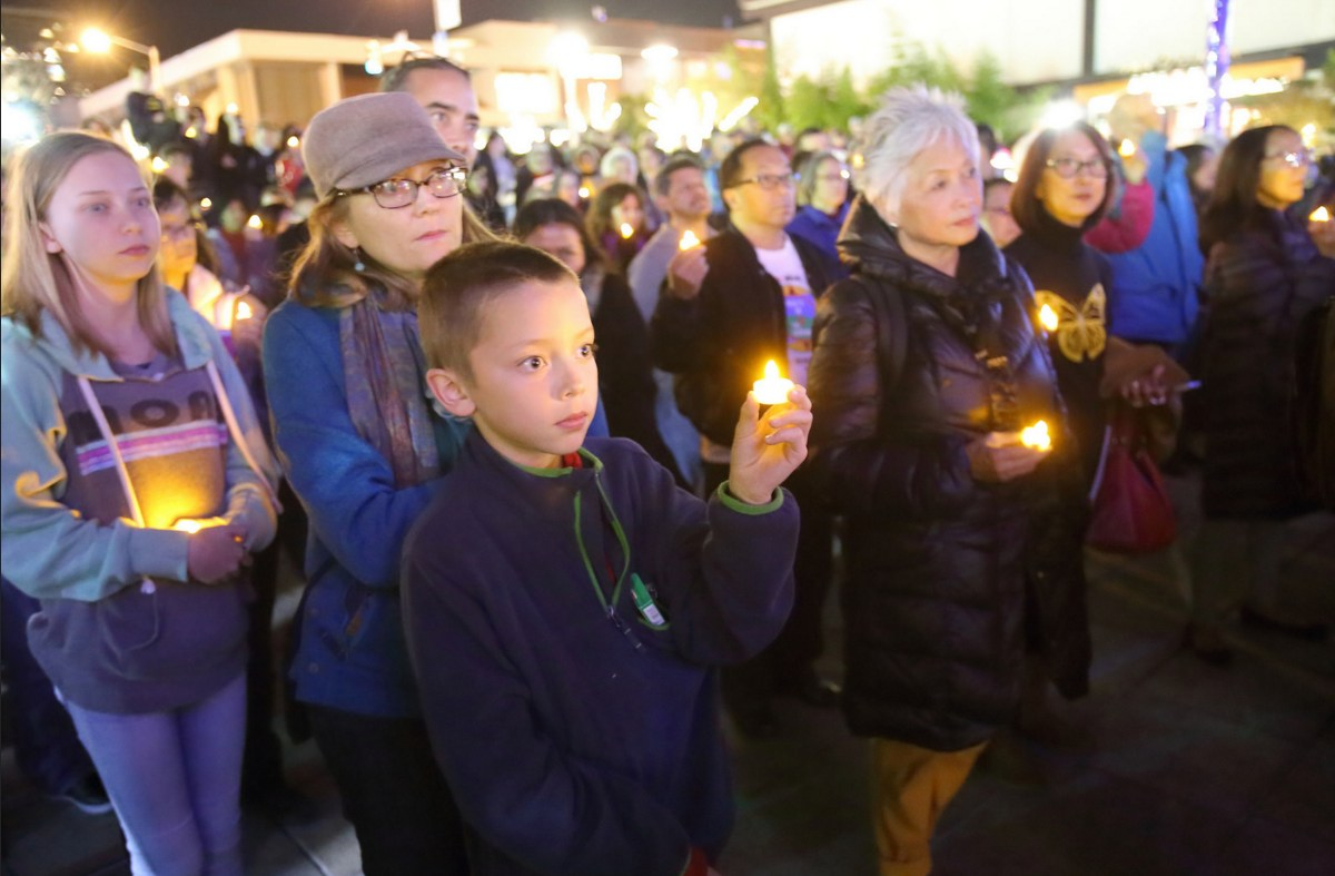 Vigil participants held candles as they gathered in San Francisco Japantown's Peace Plaza.
