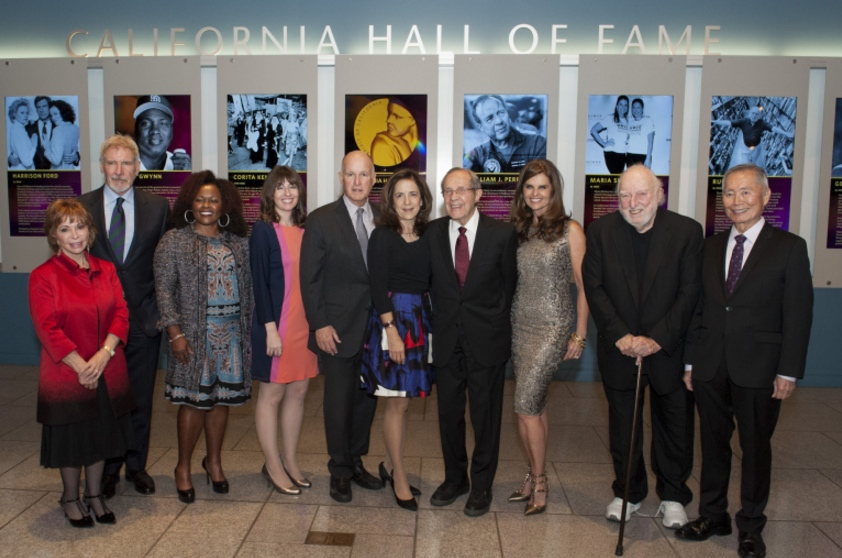 The 10th class of California Hall of Fame inductees (from left): Isabel Allende, Harrison Ford, Alicia Gwynn (representing Tony Gwynn), Ray Smith (representing Corita Kent), Gov. Jerry Brown, First Lady Anne Gust Brown, William J. Perry, Maria Shriver, Russ Solomon and George Takei. (Photo by  Joe McHugh/California Highway Patrol)