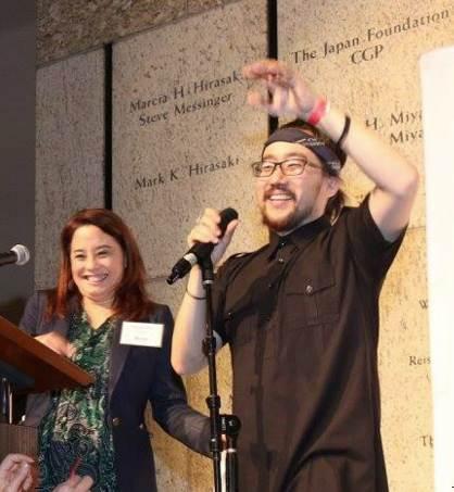 Emcee Helen Ota with featured performer Jason Chu.